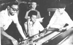 Augustus Pablo (far right) in the studio